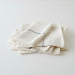 serviette lin blanc liseré noir de chez Charvet Editions