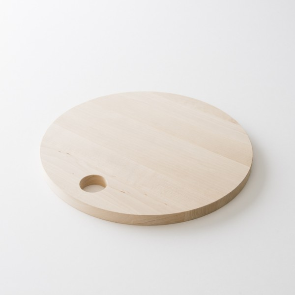 planche à découper ronde en bois de chez Iris Hantverk